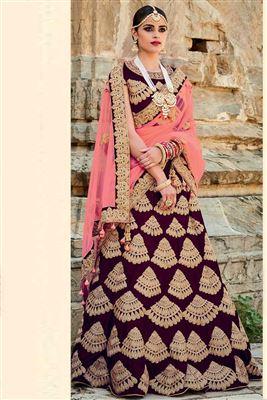 image of Magenta Color Bridal Wear Embroidered Net Lehenga Choli