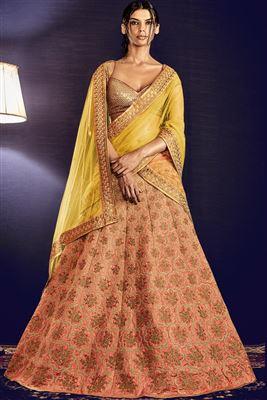 image of Silk Fabric Bridal Wear Designer Lehenga Choli in Peach And Yellow Color