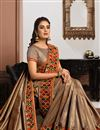photo of Satin Silk Fabric Puja Wear Chikoo Color Embroidered Saree