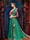 photo of Dark Green Weaving Work Party Wear Art Silk Fancy Saree