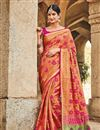 image of Party Wear Patola Art Silk Saree In Orange With Weaving Work