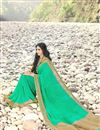 photo of Party Wear Glamorous Green Color Printed Georgette Saree