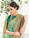 photo of Designer Festive Wear Georgette And Silk Saree In Beautiful Green Color