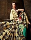 photo of Cream Color Soothing Crepe Printed Saree