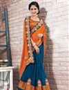photo of Beguiling Orange And Blue Color Designer Saree In Georgette Fabric