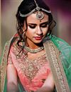 photo of Courtly Peach Color Wedding Wear 3 Piece Lehenga Choli In Net Fabric
