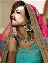 photo of Tempting Turquoise Color Wedding Wear Net Lehenga Choli