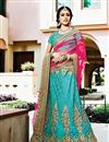 image of Tempting Turquoise Color Wedding Wear Net Lehenga Choli