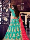 photo of Attractively Embroidered Designer Net Lehenga Choli In Cyan Color