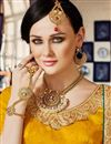 photo of Splendid Yellow Color Party Wear Designer Net Lehenga Choli With Embroidery Work