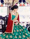 photo of Attractively Embroidered Designer Net Lehenga Choli In Teal Color