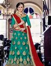 image of Attractively Embroidered Designer Net Lehenga Choli In Teal Color