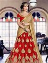 image of Attractively Embroidered Designer Net Lehenga Choli In Red Color