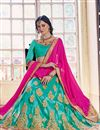 photo of Splendid Cyan Color Party Wear Designer Net Fabric Lehenga Choli With Embroidery Work