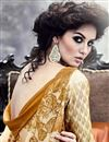 photo of Dazzling Beige And Brown Color Party Wear Printed Georgette Saree