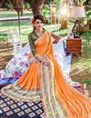 photo of Delightful Orange Color Printed Party Wear Georgette Saree