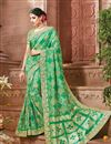 image of Fancy Fabric Green Color Party Wear Saree With Unstitched Designer Blouse