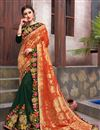 image of Incredible Embroidery Work On Dark Green Color Fancy Fabric Party Wear Saree