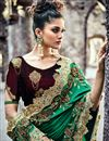 photo of Wedding Special Embroidered Satin And Net Dark Green Designer Fancy Saree