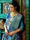 photo of Impressive Party Wear Blue Color Designer Traditional Silk Weaving Work Saree