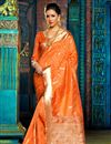 image of Stunning Orange Color Designer Traditional Silk Party Wear Saree With Weaving Work