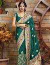image of Art Silk Fabric Trendy Puja Wear Teal Weaving Work Saree