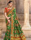 image of Festive Wear Patola Silk Fabric Saree In Green Color