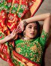 photo of Orange Color Patola Silk Fabric Saree