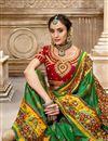 photo of Dark Green Color Patola Silk Fabric Festive Wear Saree