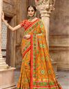 image of Function Wear Orange Color Saree In Patola Silk Fabric