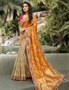 image of Function Wear Orange Color Classy Weaving Work Saree In Silk Fabric