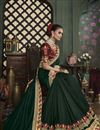 photo of Fancy Dark Green Color Art Silk Fabric Sangeet Wear Border Work Saree