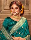 photo of Puja Wear Teal Color Chic Art Silk Fabric Weaving Work Saree