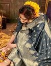 photo of Puja Wear Art Silk Fabric Chic Grey Color Weaving Work Saree