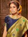 photo of Puja Wear Art Silk Fabric Chic Green Color Weaving Work Saree