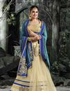 image of Yuvika Chaudhary Featuring Embroidered Georgette And Net Lehenga Style Saree In Beige And Blue Color With Unstitched Blouse
