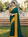 image of Prachi Desai Featuring Teal Color Embroidery Work On Festive Wear Saree In Chiffon Fabric With Mesmeric Blouse