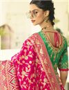 photo of Banarasi Silk Fabric Rani Color Function Wear Weaving Work Saree With Embroidered Blouse