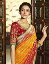 picture of Eid Special Banarasi Silk Function Wear Orange Weaving Work Saree With Embroidered Blouse