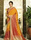 image of Eid Special Banarasi Silk Function Wear Orange Weaving Work Saree With Embroidered Blouse