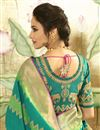 photo of Eid Special Cyan Banarasi Silk Fabric Function Wear Weaving Work Saree With Embroidered Blouse