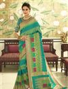 image of Eid Special Cyan Banarasi Silk Fabric Function Wear Weaving Work Saree With Embroidered Blouse