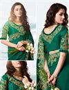 photo of Embroidered Work On Satin Silk And Net Fabric Teal Color Designer Saree With Captivating Blouse