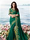 image of Eid Special Embroidered Work On Satin Silk And Net Fabric Teal Color Designer Saree With Captivating Blouse