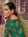 photo of Art Silk Fabric Green Color Festive Wear Saree With Weaving Work And Attractive Blouse