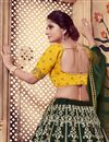 photo of Scrupulously Embroidered Dark Green Color Festive Wear Designer Lehenga Choli In Art Silk Fabric