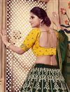 photo of Scrupulously Embroidered Dark Green Color Festive Wear Designer Lehenga Choli In Art Silk Fabric