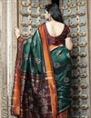 photo of Art Silk Chic Festive Wear Dark Green Color Patola Weaving Work Saree