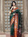 image of Art Silk Chic Festive Wear Dark Green Color Patola Weaving Work Saree