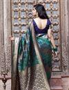 photo of Festive Wear Cyan Color Art Silk Fabric Patola Weaving Work Saree